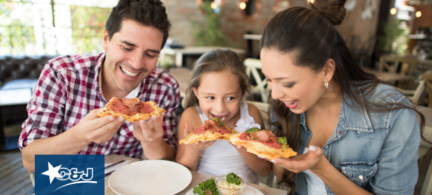 Family eating pizza in Boston's North End